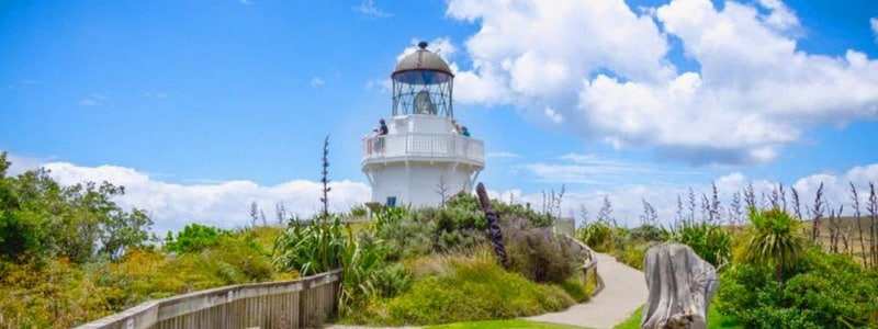 Manukau Heads lighthouse with Travellers Autobarn
