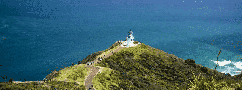 Imagine a lone lighthouse, standing tall against the sea. That is the Cape Regina Lighthouse. If you're looking for a view where the Tasman Sea meets the vastness of the Pacific Ocean, head to this secluded spot, which is as far north on the mainland as you can go.