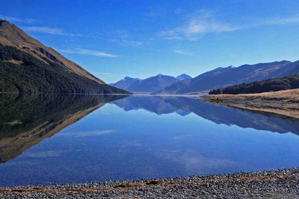 Located about an hour and a half from Te Anau is the secluded but stunning Mavora Lakes Campsite.