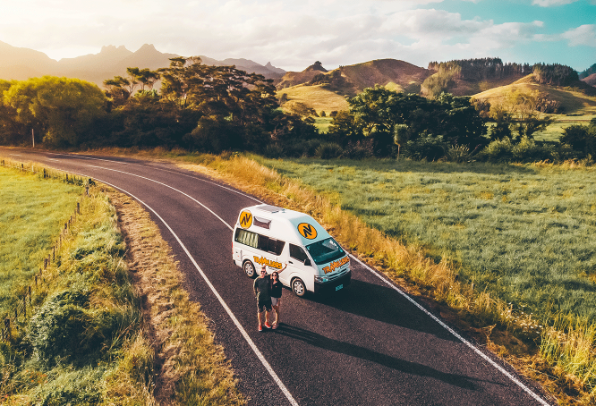 Couple parked in New Zealand with a Kuga Campervan.