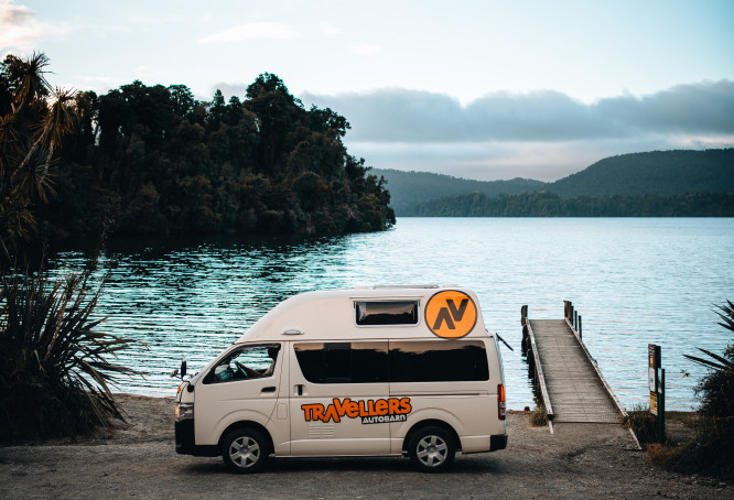 Traveller's Autobarn van stopped lakeside in NZ